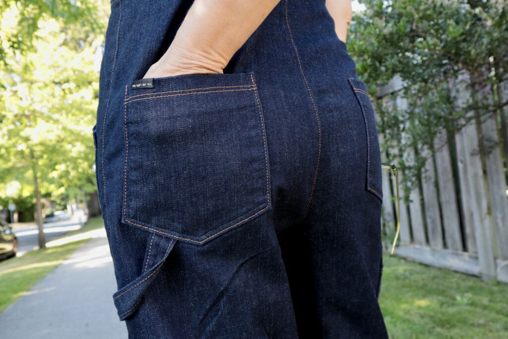 Close up of back pocket and hammer loop on denim overalls